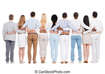 United team. Full length rear view of group of diverse people bonding to each other while standing against white background