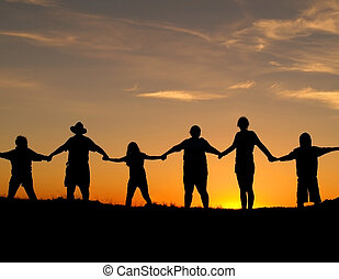 Unity and Strength - Many people join hands to represent a...