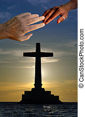 Unity in Christ - Large concrete cross silhouette over a...