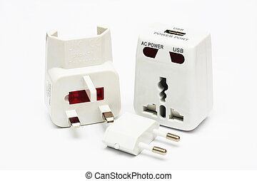 An disassembled universal plug adapter on white background