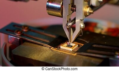 Universal wire bonder microelectronic equipment in work close-up