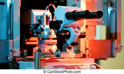Universal wire bonder microelectronic equipment in work in the laboratory