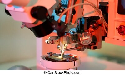 Universal wire bonder microelectronic equipment in work in the