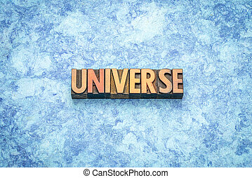 universe word abstract in wood type