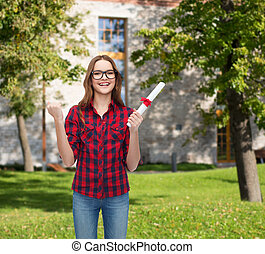 smiling female student in eyeglasses with diploma - ...