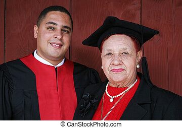 University graduate in robes with his grandmother.