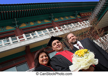 University graduate with his parents
