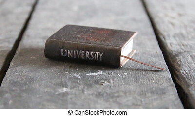 university idea - Vintage book with inscription University