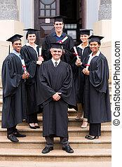 university professor and graduates at graduation