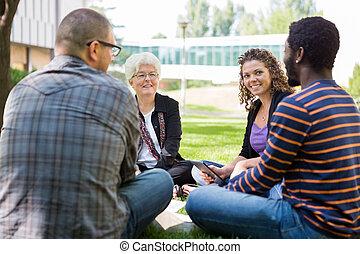 University Professor Helping Students Outdoors