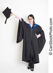 University student hand holding mortarboard
