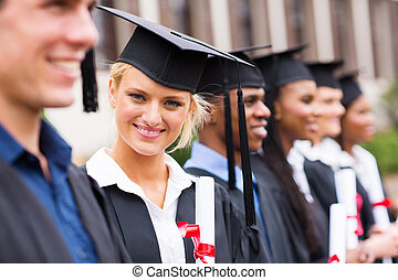 university student in graduation attire - pretty university...