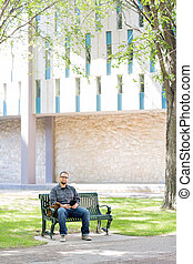 University Student Sitting On Bench At Campus