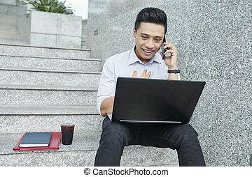 University student sitting on steps