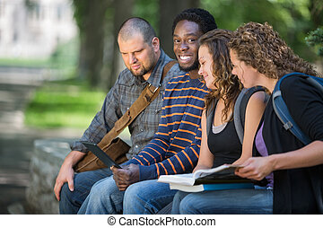 University Student Sitting With Friends On Campus