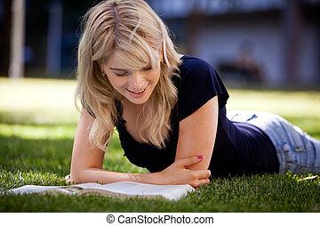 University Student Studying Outdoors