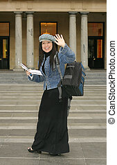 University - Student waving to fellow students