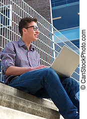 University student working on laptop outdoors
