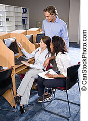 University students at library computer studying