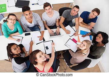 University Students Doing Group Study - High angle view of...