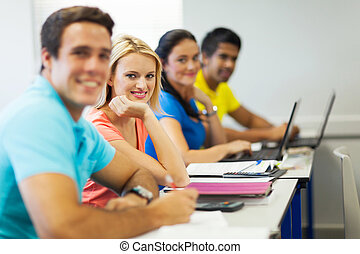 university students in lecture hall