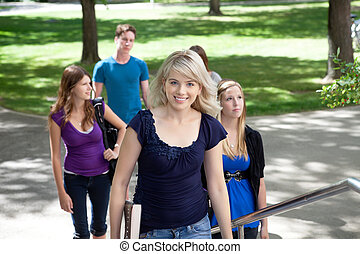 University Students - Portrait of young girl going to...
