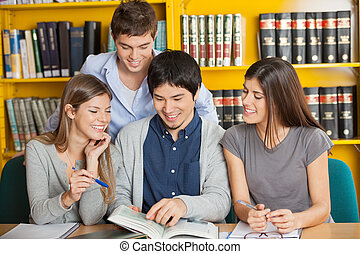 University Students Studying Together In Library