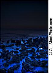 Unknown - Bluish beach rocks with blackened horizon.