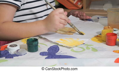Unknown child drawing picture with watercolours