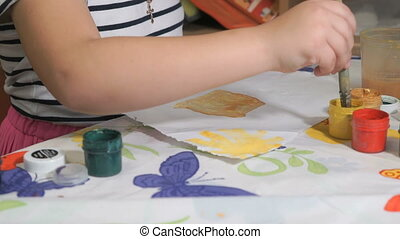 Unknown child drawing picture with watercolours - Close-up...