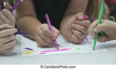Unknown children paint pictures with felt-tip - Close-up of...