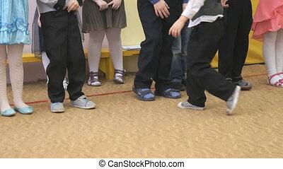 Unknown children standing in line - Unknown children stand...