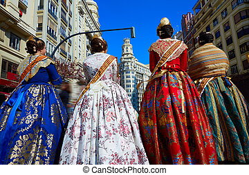 Unknown falleras dress from Valencia Fallas fest in a row at...