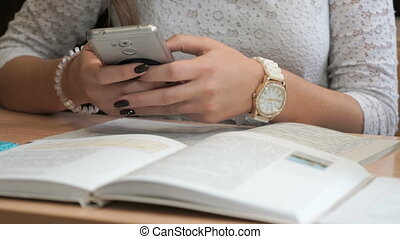 Unknown girl student with smartphone