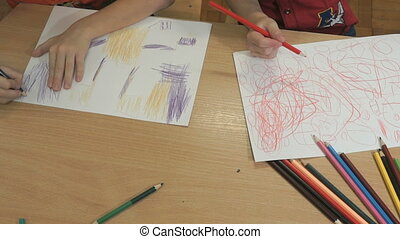 Unknown little boys drawing pictures. Close-up - Close-up of...