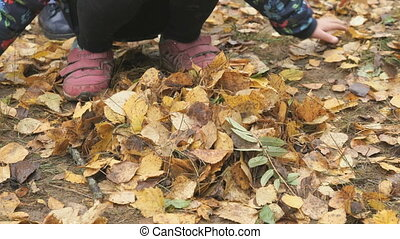 Unknown little child in autumnal park