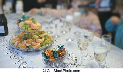Unknown men pouring sparkling wine in glasses - Wedding...