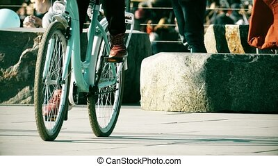 Unknown people riding classic bicycles on the street -...