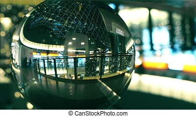 Unknown people walk in a modern shopping mall view through...