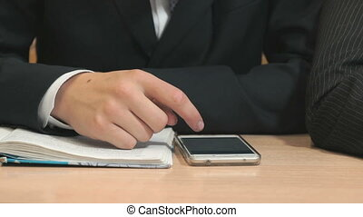 Unknown student typing text using smartphone - Close-up of...