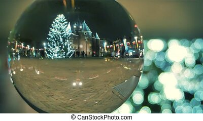 Unknown tourists walk on the square decorated for Christmas...