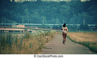 Unknown young woman running in the park - Unknown woman...