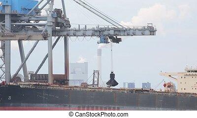 Unloading a huge ship - Unloading coal from a bulk carrier...
