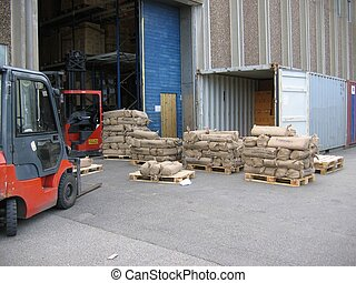 Unloading Container - A container beeing unloaded outside a ...