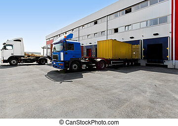 Unloading trucks - Unloading big container trucks at...