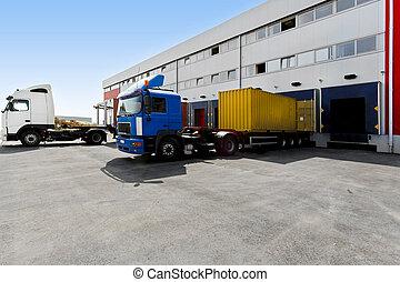 Unloading trucks - Unloading big container trucks at...