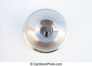Unlock it! - Closeup of metallic door lock with focus on ...