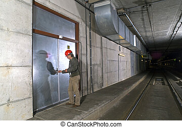 Unlocking a door - A man with a hard hat in his hand...