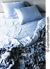Unmade bed and bedding - Unmade messy bed with wrinkled...