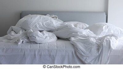 Unmade bed with white linen - White unmade bed with crumpled...